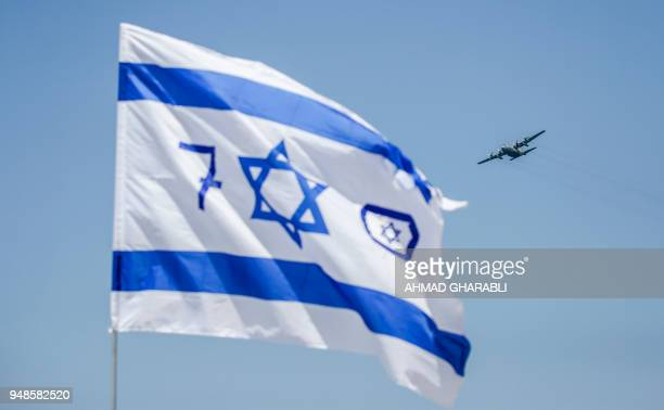 A USmade Israeli air force C130 Hercules transport aircraft flies over during an air show as part of the 70th Independence Day celebrations on April...