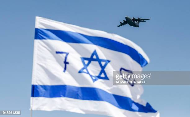 A USmade Israeli air force C17 Globemaster III transport aircraft flies over during an air show as part of the 70th Independence Day celebrations on...