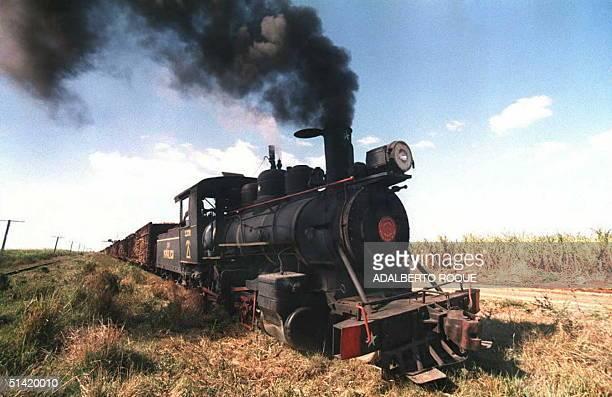 USmade steam locomotive pulls freight cars loaded with freshly cut sugar cane 21 August at a plantation 60 Km south of HavanaCuba The Cuban sugar...