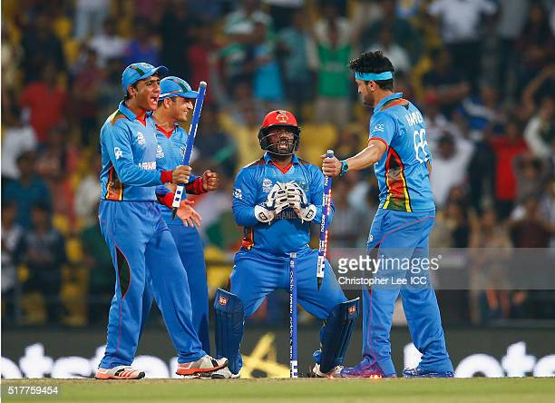 Usman Ghani Amir Hamza Mohammad Shahzad and Hamid Hassan of Afghanistan celebrate their victory during the ICC World Twenty20 India 2016 Group 1...