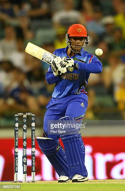 Usman Ghani of Afghanistan avoids a high delivery during the 2015 ICC Cricket World Cup match between Australia and Afghanistan at WACA on March 4...