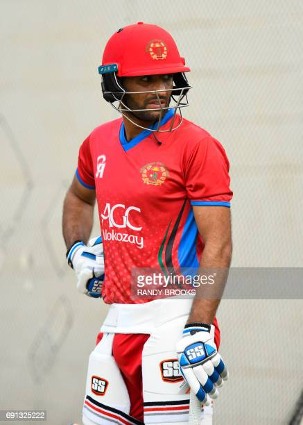 Usman Ghani of Afghanistan take part in a training session at Warner Park on June 1 2017 in Basseterre St Kitts ahead of the West Indies vs...