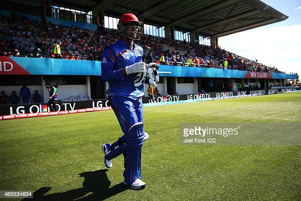 Usman Ghani of Afghanistan walks onto the field during the 2015 ICC Cricket World Cup match between New Zealand and Afghanistan at McLean Park on...