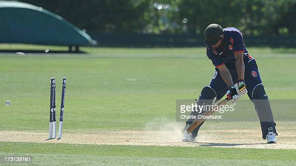 Usman Khan of France is bowled out during the European Division 1 Championship Group B match between Jersey and France at Preston Nomads Cricket Club...