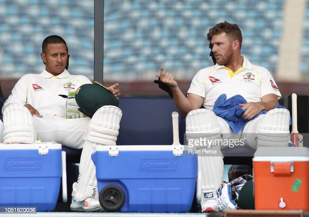 Usman Khawaja and Aaron Finch of Australia prepares to open the batting during day three of the First Test match in the series between Australia and...