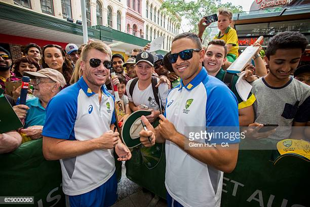 R Usman Khawaja and David Warner signing autographs at the Commonwealth Bank Test Series Launch at Queen Street Mall on December 11 2016 in Brisbane...