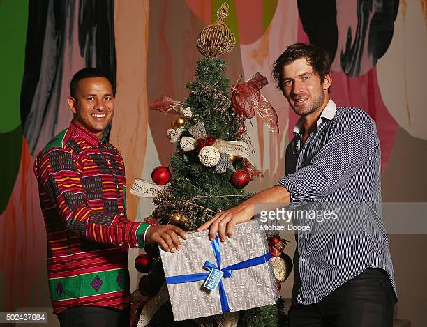 Usman Khawaja and Joe Burns pose during the Australian Test Squad Christmas Day Luncheon at Crown Entertainment Complex on December 25 2015 in...