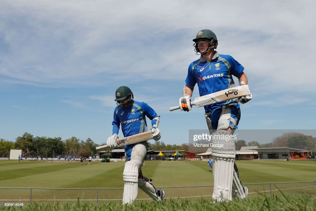 Usman Khawaja (L) and Josh Hazlewood of Australia walk to the nets during an Australia Test cricket squad training session at Marrara Cricket Ground on August 13, 2017 in Darwin, Australia.