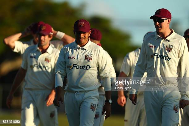 Usman Khawaja and Matthew Renshaw of Queensland leaves the field during day one of the Sheffield Shield match between Queensland and New South Wales...