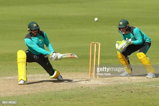 Usman Khawaja bats during an Australian ODI training session at Allan Border Field on May 28, 2018 in Brisbane, Australia.