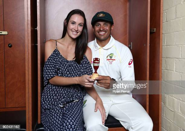 Usman Khawaja of Australia and his fiance Rachel McLellan pose with the Ashes Urn in the change rooms during day five of the Fifth Test match in the...