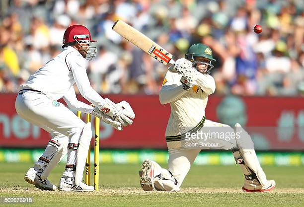 Usman Khawaja of Australia bats as wicketkeeper Denesh Ramdin of the West Indies looks on during day three of the Second Test match between Australia...