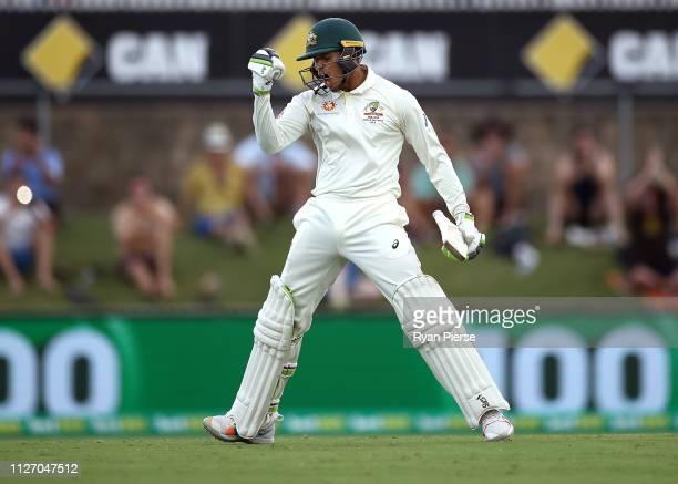Usman Khawaja of Australia celebrates after reaching his century during day three of the Second Test match between Australia and Sri Lanka at Manuka...