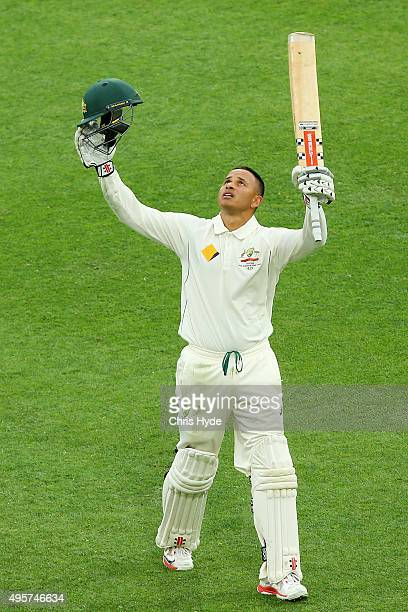 Usman Khawaja of Australia celebrates after reaching his century during day one of the First Test match between Australia and New Zealand at The...