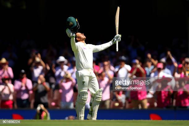 Usman Khawaja of Australia celebrates after reaching his century during day three of the Fifth Test match in the 2017/18 Ashes Series between...