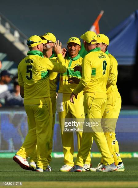 Usman Khawaja of Australia celebrates after taking a catch during game two of the One Day International series between Australia and India at...