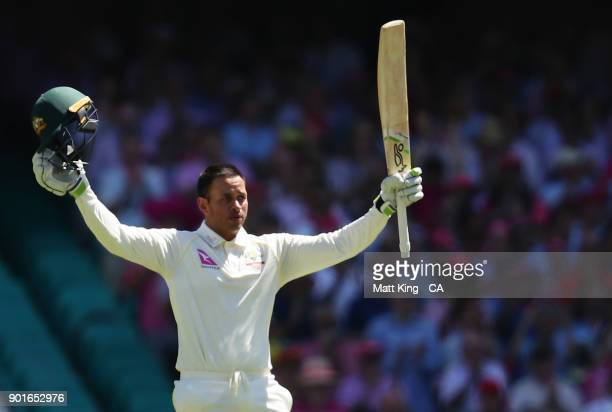 Usman Khawaja of Australia celebrates and acknowledges the crowd after scoring a century during day three of the Fifth Test match in the 2017/18...