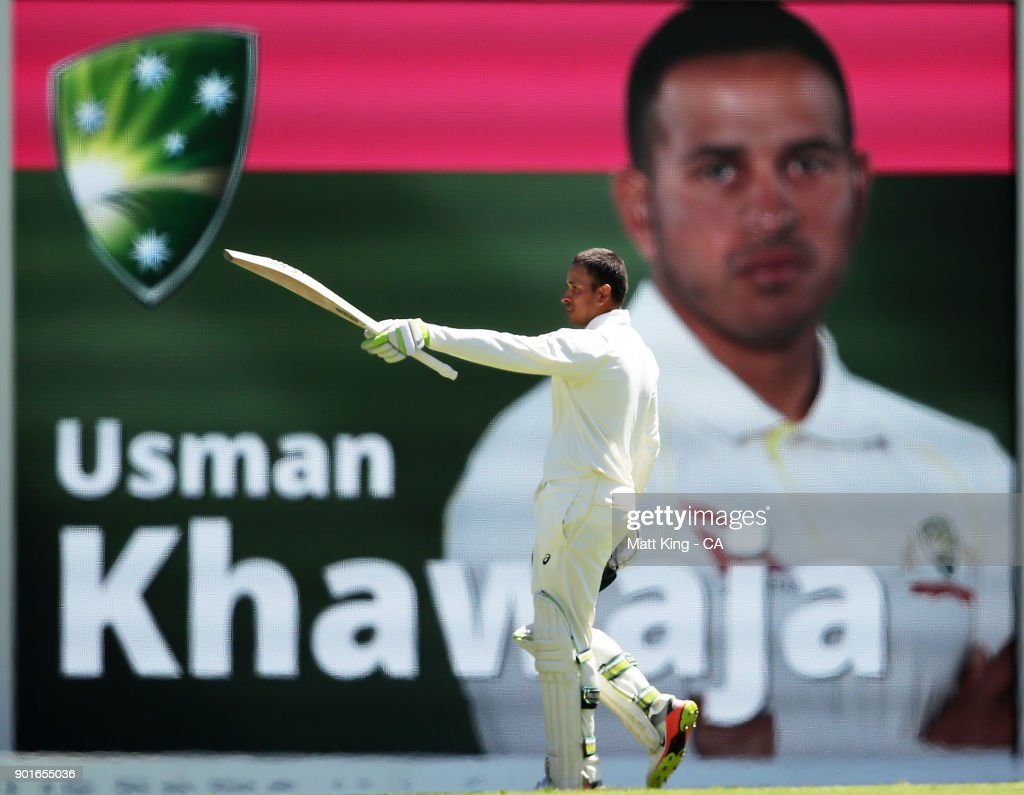 Usman Khawaja of Australia celebrates and acknowledges the crowd after scoring a century during day three of the Fifth Test match in the 2017/18 Ashes Series between Australia and England at Sydney Cricket Ground on January 6, 2018 in Sydney, Australia.