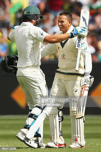 Usman Khawaja of Australia celebrates his century with Joe Burns during day one of the Second Test match between Australia and the West Indies at...