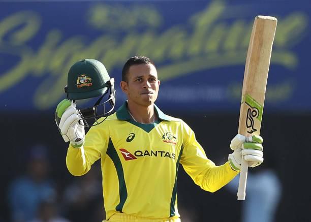 Usman Khawaja of Australia celebrates scoring his century during game three of the One Day International series between India and Australia at JSCA...