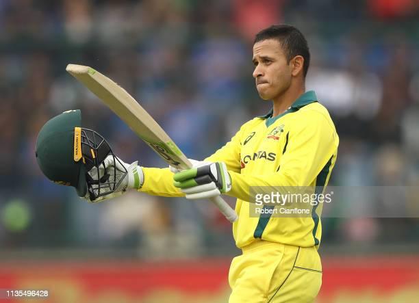 Usman Khawaja of Australia celebrates scoring his century during game five of the One Day International series between India and Australia at Feroz...