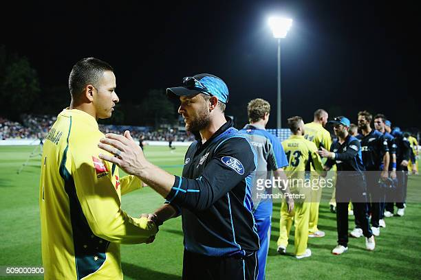 Usman Khawaja of Australia congratulates Brendon McCullum of the Black Caps after losing the 3rd One Day International cricket match between the New...