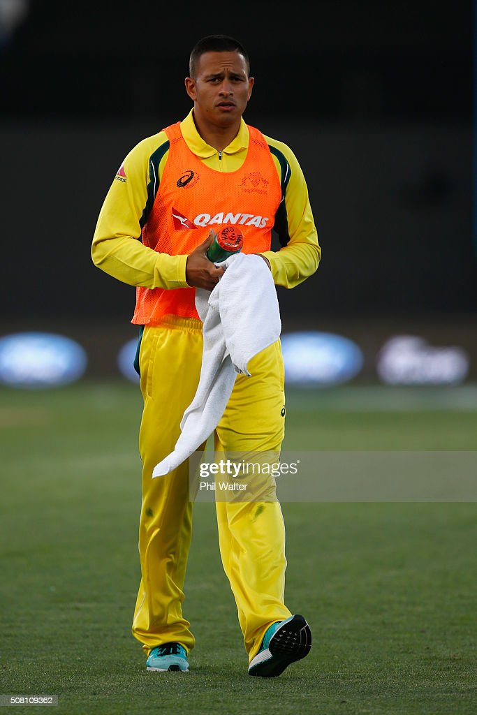 Usman Khawaja of Australia delivers drinks during the One Day International match between New Zealand and Australia at Eden Park on February 3, 2016 in Auckland, New Zealand.