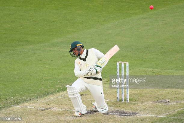 Usman Khawaja of Australia ducks under a bouncer during the Four Day match between Australia A and the England Lions at Melbourne Cricket Ground on...