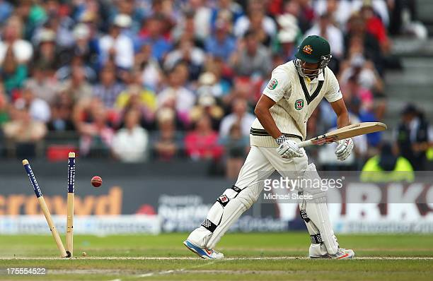 Usman Khawaja of Australia is bowled by Graeme Swann of England during day four of the 3rd Investec Ashes Test match between England and Australia at...