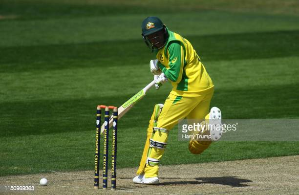 Usman Khawaja of Australia is hit from the bowling of Andre Russell of West Indies and forced to retire hurt during the One Day International match...
