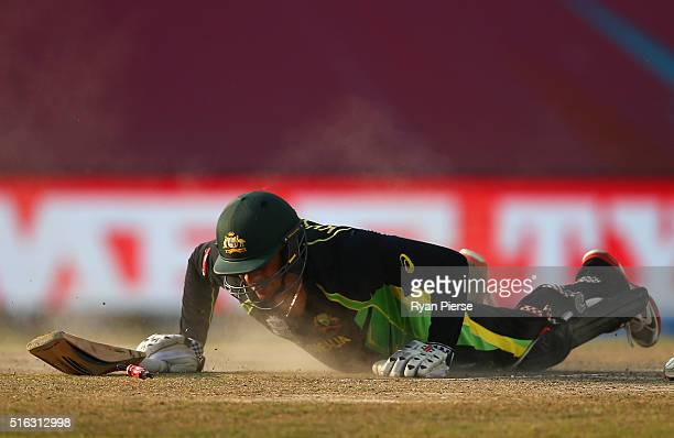 Usman Khawaja of Australia is run out by Grant Elliott of New Zealand during the ICC World Twenty20 India 2016 Super 10s Group 2 match between...