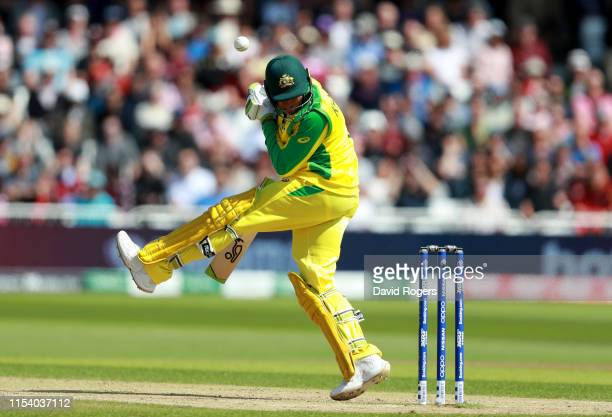 Usman Khawaja of Australia is struck on the head from a delivery from Oshane Thomas during the Group Stage match of the ICC Cricket World Cup 2019...