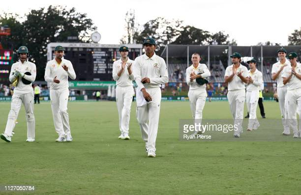 Usman Khawaja of Australia leads his team from the ground at stumps during day three of the Second Test match between Australia and Sri Lanka at...