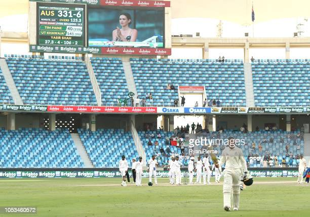 Usman Khawaja of Australia leaves the ground after being dismissed for 141 runs by Yasir Shah of Pakistan during day five of the First Test match in...