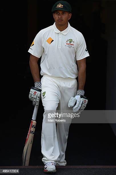 Usman Khawaja of Australia poses during a portrait session at The Gabba on November 3 2015 in Brisbane Australia
