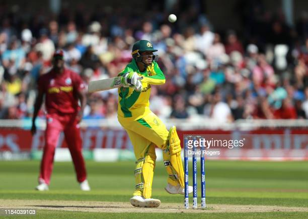 Usman Khawaja of Australia pulls the ball to the boundary during the Group Stage match of the ICC Cricket World Cup 2019 between Australia and the...