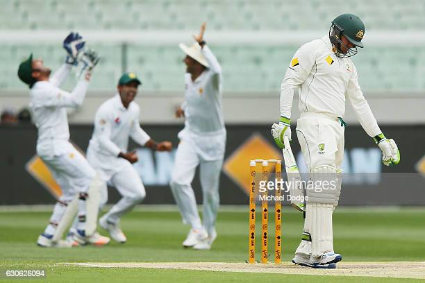 Usman Khawaja of Australia reacts after being caught out for 98 during day four of the Second Test match between Australia and Pakistan at Melbourne...