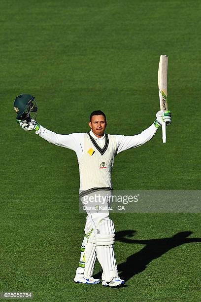 Usman Khawaja of Australia reacts after reaching his century during day two of the Third Test match between Australia and South Africa at Adelaide...