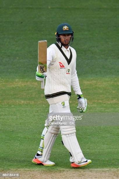Usman Khawaja of Australia reacts after reaching his half century during day one of the Second Test match during the 2017/18 Ashes Series between...