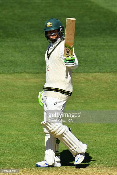 Usman Khawaja of Australia reacts as he reaches his half century during day two of the Third Test match between Australia and South Africa at...