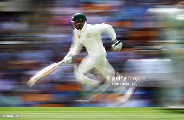 Usman Khawaja of Australia runs between wickets during day two of the First Test match between Australia and New Zealand at The Gabba on November 6...