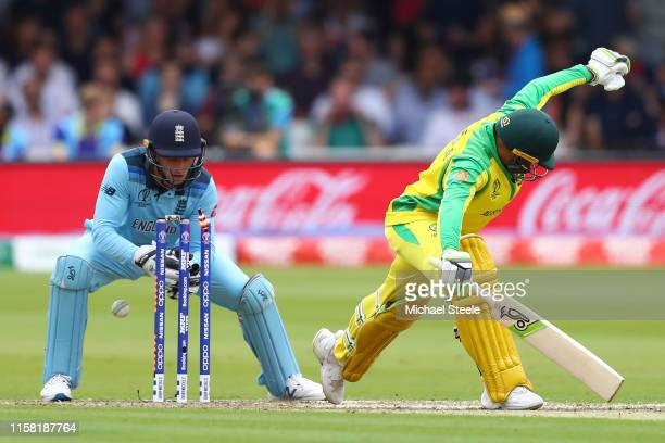 Usman Khawaja of Australia survives a missed stumping from England wicketkeeper Jos Buttler off the bowling of Adil Rashid during the Group Stage...