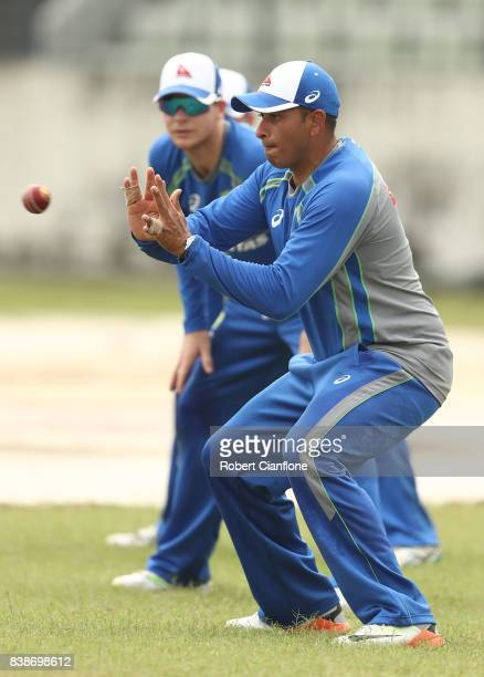 Usman Khawaja of Australia takes a catch during an Australian Test team nets session at SherE Bangla National Cricket Stadium on August 25 2017 in...