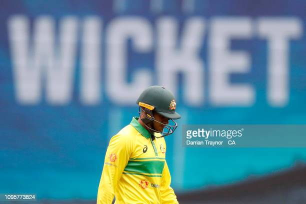 Usman Khawaja of Australia walks from the field after being dismissed during game three of the One Day International series between Australia and...
