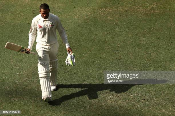Usman Khawaja of Australia walks from the ground at tea during day five of the First Test match in the series between Australia and Pakistan at Dubai...