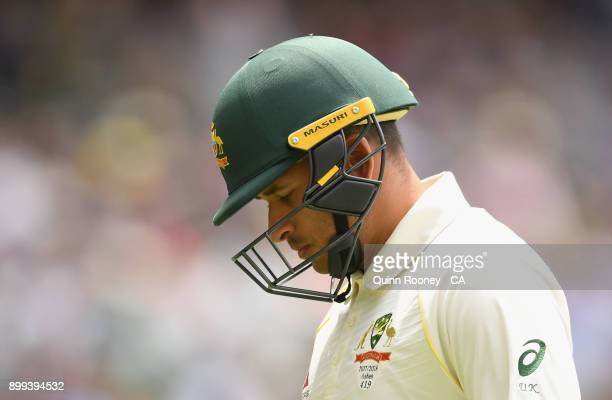 Usman Khawaja of Australia walks off the field after being dismissed by James Anderson of England during day four of the Fourth Test Match in the...