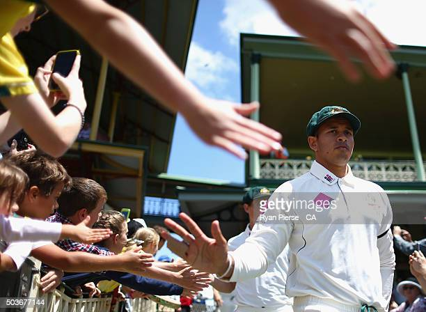 Usman Khawaja of Australia walks out to field during day five of the third Test match between Australia and the West Indies at Sydney Cricket Ground...