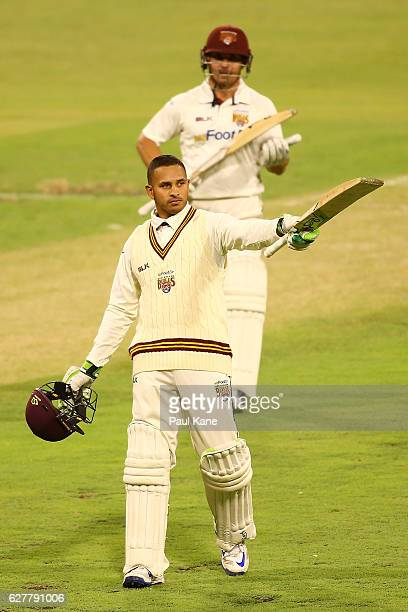 Usman Khawaja of Queensland acknowledges the rooms after scoring his century during day one of the Sheffield Shield match between Western Australia...