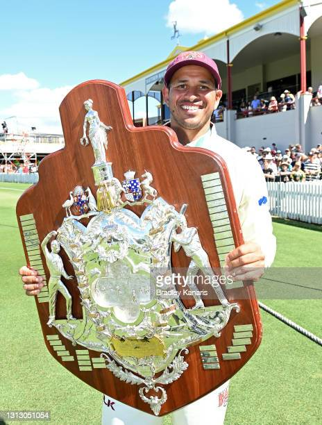 Usman Khawaja of Queensland celebrates victory during day four of the Sheffield Shield Final match between Queensland and New South Wales at Allan...
