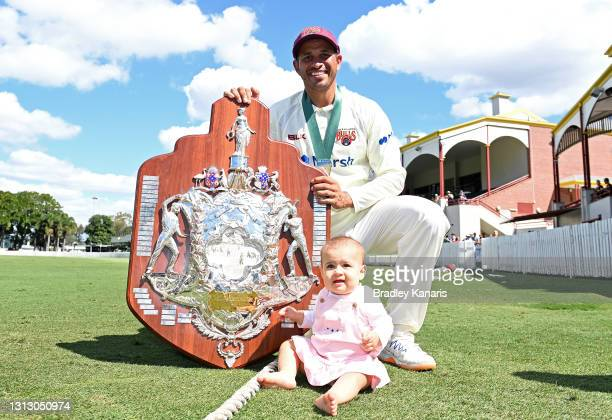Usman Khawaja of Queensland celebrates victory with daughter Aisha Khawaja during day four of the Sheffield Shield Final match between Queensland and...
